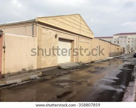 Garage entrance gate on the asphalt - stock photo