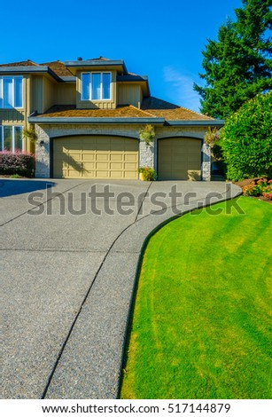 Garage, garage doors with long driveway.