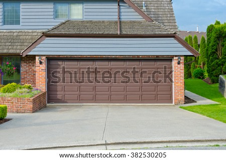 Garage with wide, long driveway.