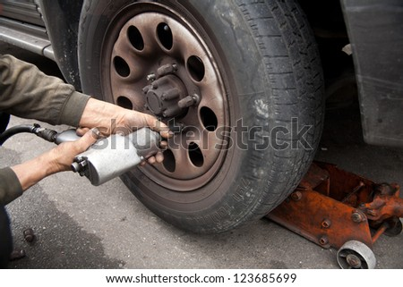 Garages and car repairing/Garages and car fixing - stock photo