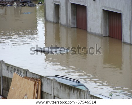 garages and cars drowned by the floods - stock photo