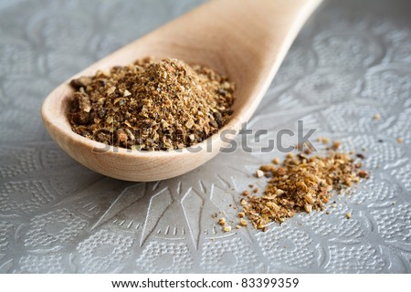 Garam Masala on a wooden spoon. - stock photo