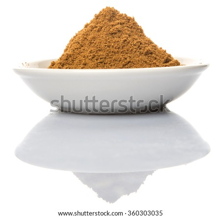 Garam masala or mix spices blend in white bowl over white background - stock photo