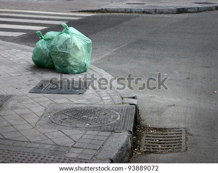 garbage bag on street - stock photo
