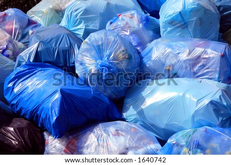 Garbage bags by a city street. - stock photo