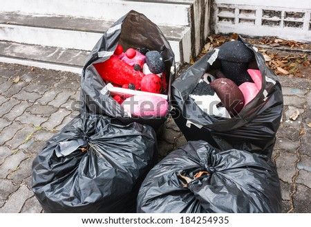 Garbage bags of garbage waiting to leave - stock photo
