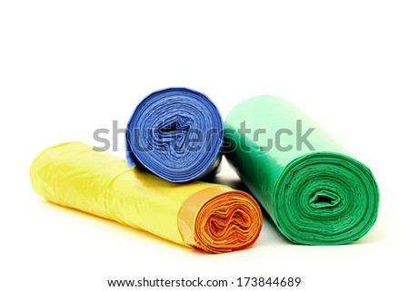 Garbage bags rolls on a white background - stock photo