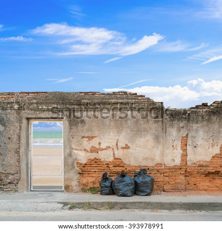 Garbage bags with old brick wall background. - stock photo