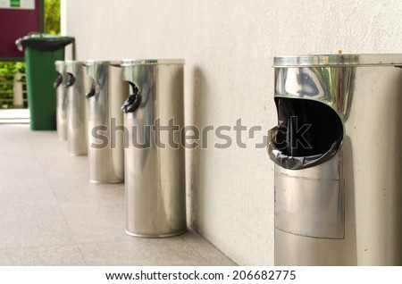 Garbage bin of steel stainless outside a building. - stock photo