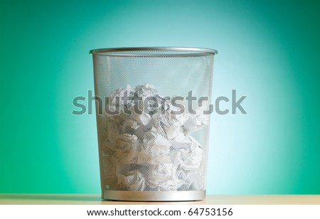 Garbage bin with paper waste isolated on white - stock photo