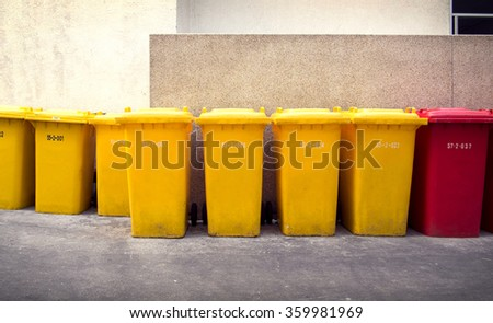 Garbage bins, yellow and red