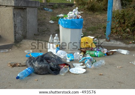 garbage can after week-end - stock photo