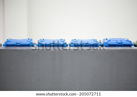 Garbage cans for paper symbolizing recycling in Germany - stock photo