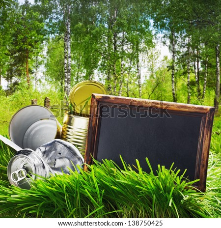 garbage cans of canned and blackboard - stock photo