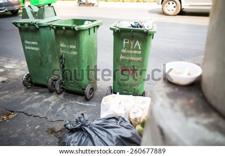 Garbage consisting of glass, plastic, metal and paper on the street in bangkok - stock photo