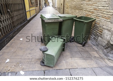 Garbage containers lying in the street, garbage detail lying in the street, dirt and debris, recycle - stock photo
