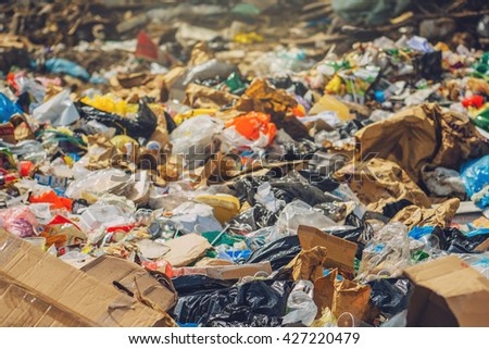 Garbage dump, various trash and waste material, environmental pollution and ecology concept, selective focus - stock photo