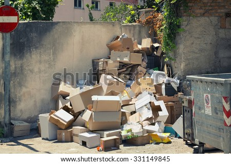 Garbage dumpsters cardboard boxes full of trash - stock photo