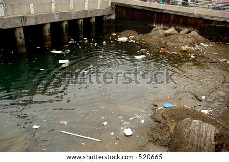 Garbage in water in a populated area. - stock photo