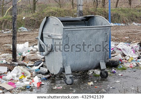 Garbage Litter and Empty Trash Bin - stock photo