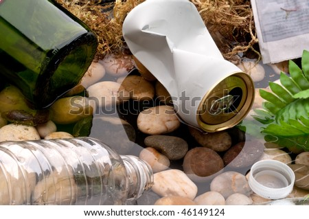 Garbage littering a stream:recycle - stock photo