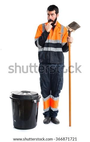 Garbage man doing vomiting gesture - stock photo