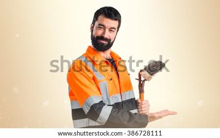 Garbage man presenting something - stock photo