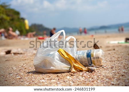 Garbage on a beach, environmental pollution concept picture. - stock photo