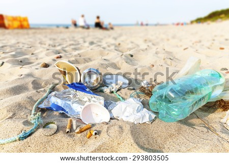 Garbage on a beach left by tourist at sunset, environmental pollution concept picture, Baltic Sea coast, Poland. - stock photo