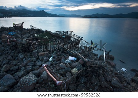 garbage on the beach at night - stock photo