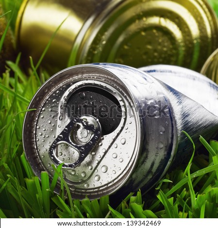 garbage on the grass. concept on the theme of environmental pollution - stock photo