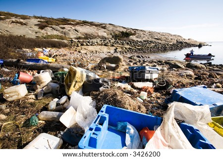 Garbage piled up on the coast of the ocean. - stock photo