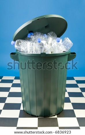 Garbage to sorting in geen wastebasket. Front view - stock photo