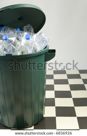 Garbage to sorting in geen wastebasket, standing on floor. - stock photo