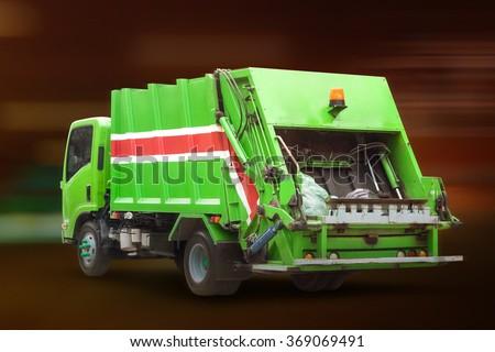 Garbage Truck at Night - stock photo