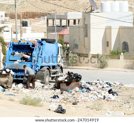 Garbage truck collecting trash - stock photo