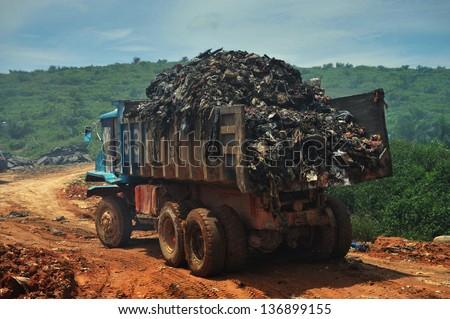 Garbage Trucks work on the landfill - stock photo