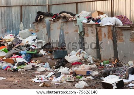 Garbage waste trash heap on recycle dump junkyard - stock photo