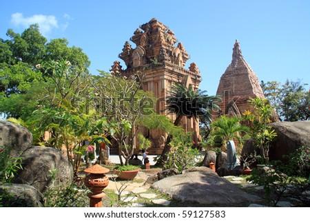 Garden and cham towers in Nha Trang, Vietnam - stock photo