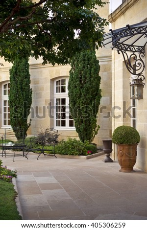 Garden and furniture on the terrace of a French mansion near Bordeaux - stock photo