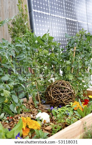 Garden and solar panel - stock photo