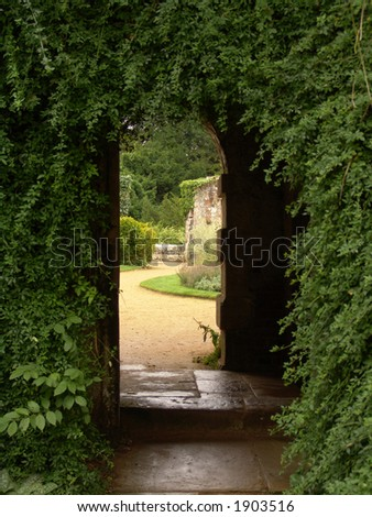 Garden arch with pathway - stock photo