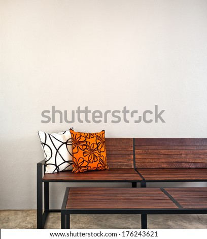 Garden bench as interior furniture with two pillow - stock photo