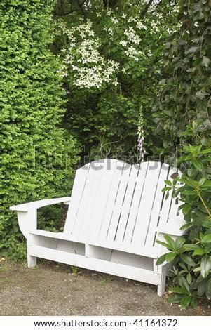 Garden Bench in a quiet garden in Oregon. - stock photo