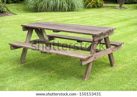 garden bench on a lawn - stock photo