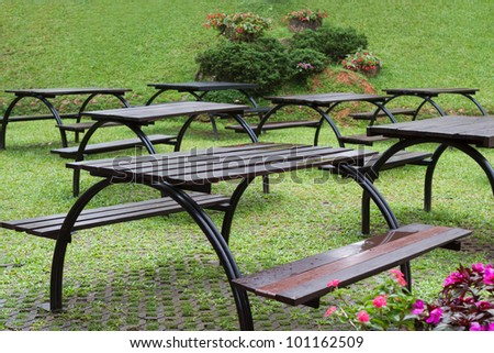 Garden benches with tables in the park
