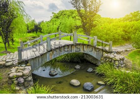 Garden bridge silence scene. - stock photo