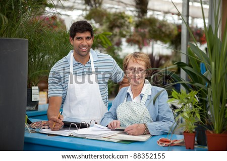 Garden Center Employees - stock photo