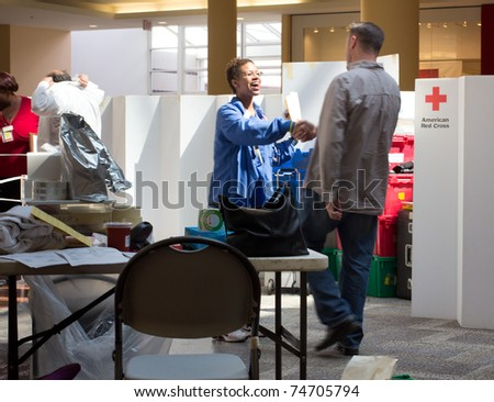 GARDEN CITY, NY - APRIL 3, 2011:  In the wake of the devastation in Japan, American Red Cross blood drive for disaster relief in Garden City, New York in Roosevelt Field Mall. - stock photo