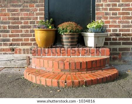Garden containers near house - stock photo